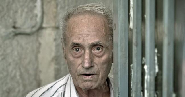 Court freezes assets of Romanian ex-prison chief