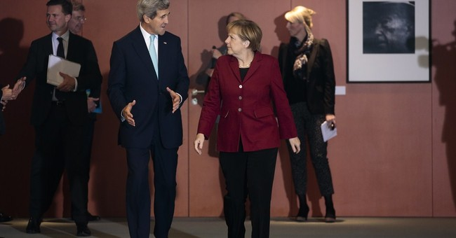 At Berlin Wall, Kerry warns against Cold War redux