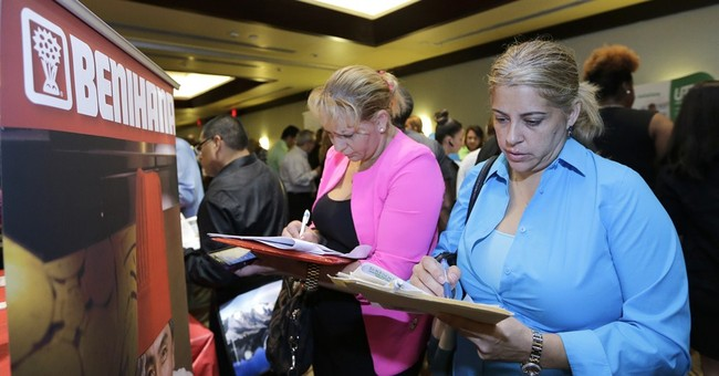 US jobless aid applications rise to 283,000
