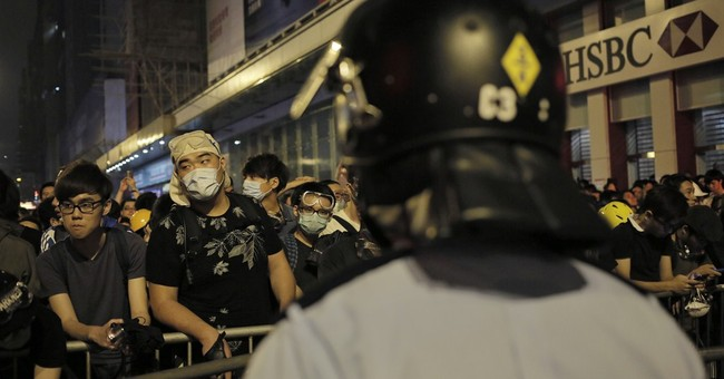 Exclusive election body at heart of HK protests
