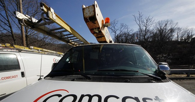 Comcast wins more Internet customers, ad sales up