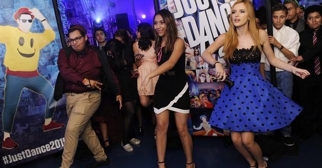 Charli XCX surprises at school homecoming dance