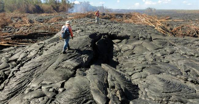 Lava creeps toward road on Hawaii's Big Island