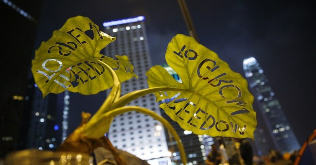 Protesters in HK to vote on staying in streets