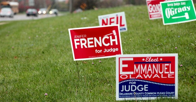 Pesky? Effective? Campaign signs spread like weeds