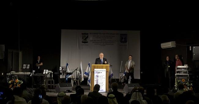 Israeli president visits Arab town, massacre site