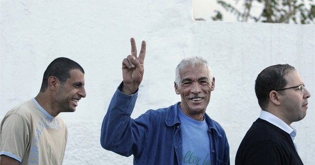 Tunisians in historic vote spurred by Arab Spring