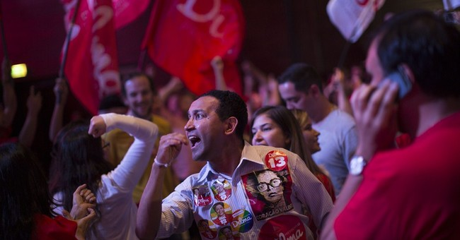 Brazil's Rousseff narrowly wins second term