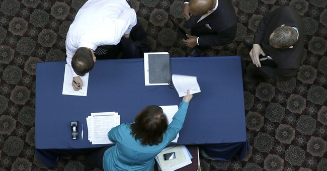 Applications for jobless benefits rise to 348,000