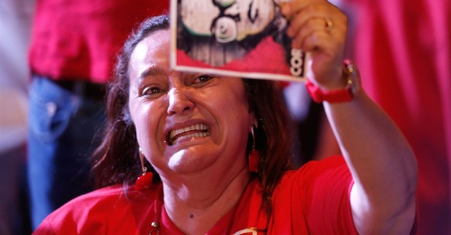 Newly re-elected Brazil leader faces house divided