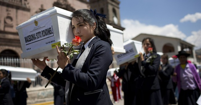Peru families receive bodies of dirty war victims