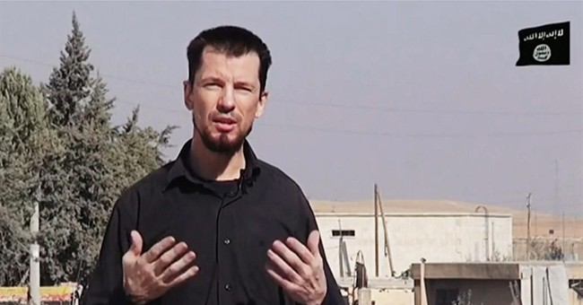 Video: Islamic State hostage 'reports' for captors