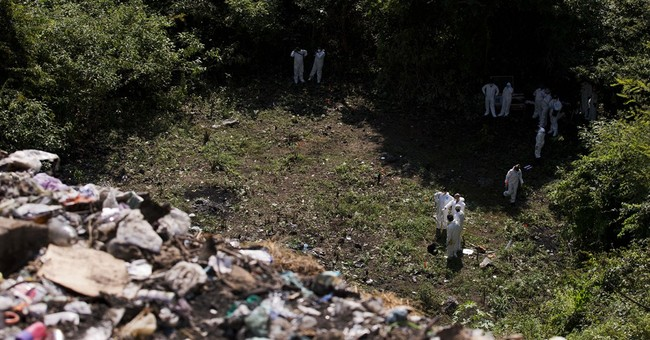 Mexico investigators comb gully for missing 43
