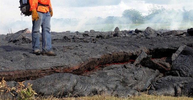 Slow-moving lava creeps closer to Hawaii homes