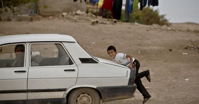 Turkish villages give Syrian Kurds shelter, hope