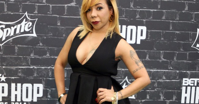 Tiny Harris defends implants to change eye color