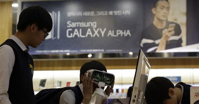 Samsung vows changes after mobile profit plunges