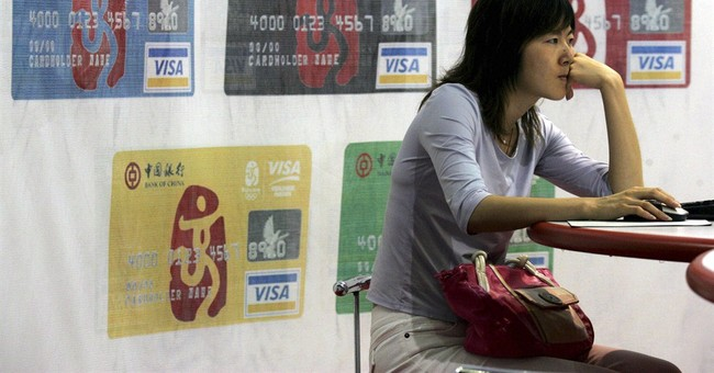 China eases monopoly on credit cards