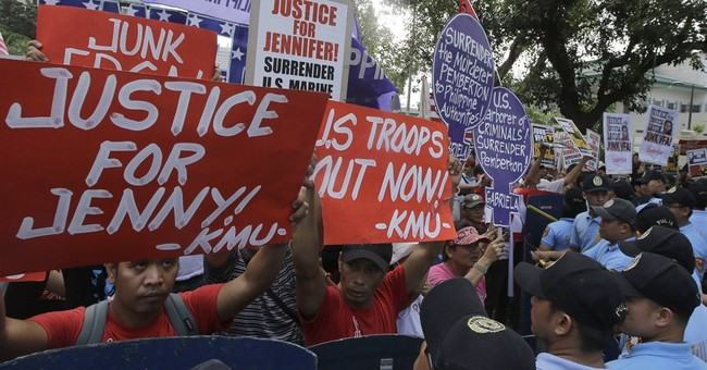 Amid murder case, Philippines says US pact stays
