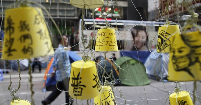 Hong Kong activists mull Beijing visit during APEC