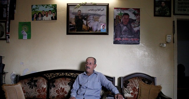 Syria's Alawites pay heavy price as they bury sons