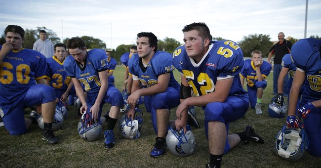 In the Nevada desert, a team elevates a town