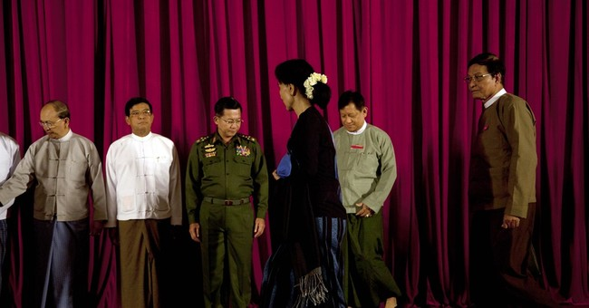 Myanmar hosts talks with Suu Kyi to show progress