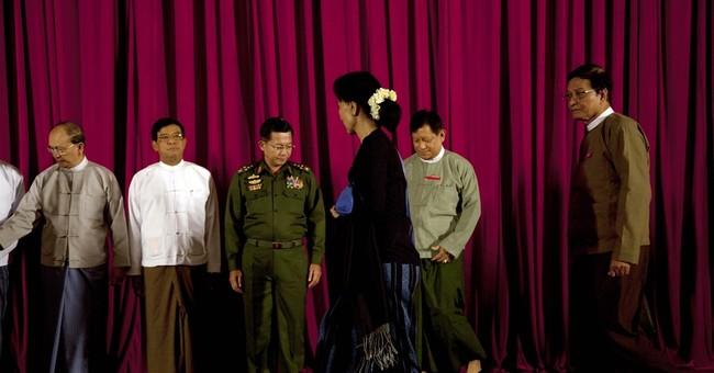 Myanmar hosts talks with Suu Kyi to show progress