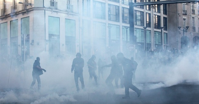 Police, youths clash at protests in French cities
