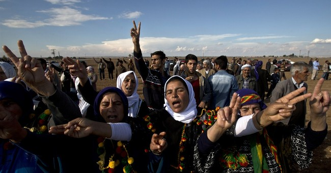Kurds in Turkey rally to back city besieged by IS