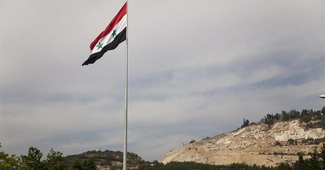 Assad's Syria truncated, battered _ but defiant