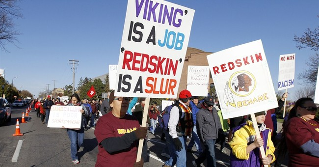 Anti-Redskins groups rally outside Vikings game