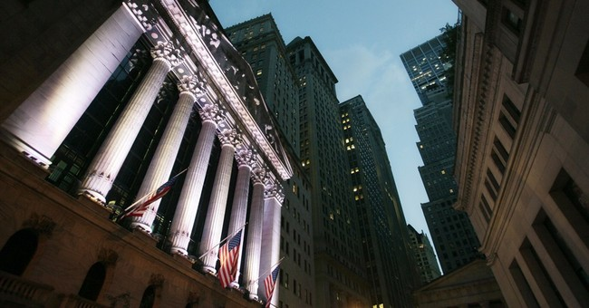Stocks waver at start of busy week of market news