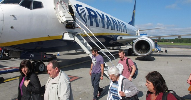 Ryanair raises outlook, soars to record high