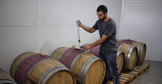 Beer, wine flow in West Bank Christian hamlet