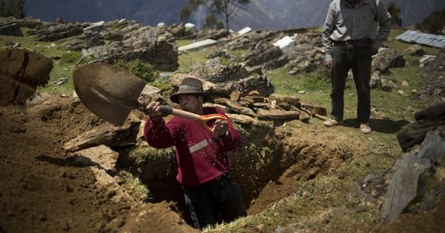 AP PHOTOS: 3 village defenders reburied in Peru