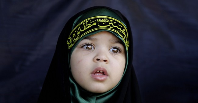 AP PHOTOS: Shiites mark slaying of revered figure