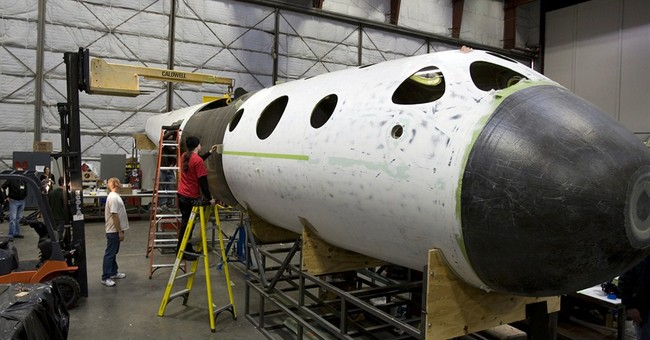 CEO: Virgin Galactic looks to resume tests in 2015