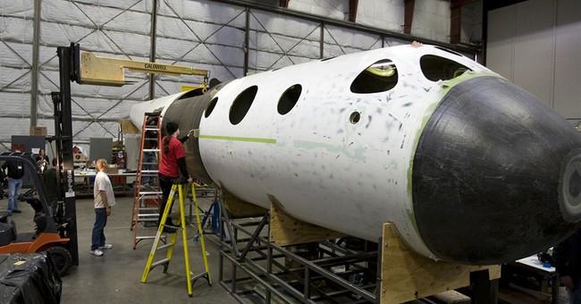 CEO: Virgin Galactic looks to resume tests in 2015