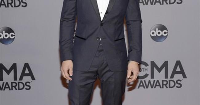Bryan wins top award, Lambert shines at CMAs