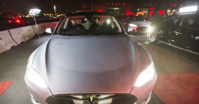 Tesla sets delivery record, but losses mount