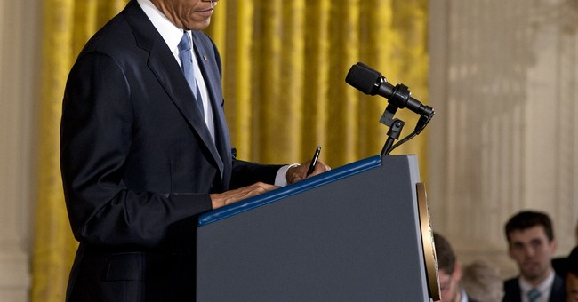 Day after defeats, Obama strikes defiant tone