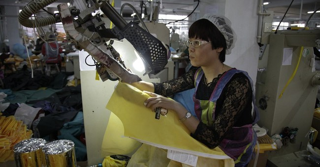China factory whirs overtime to make Ebola suits