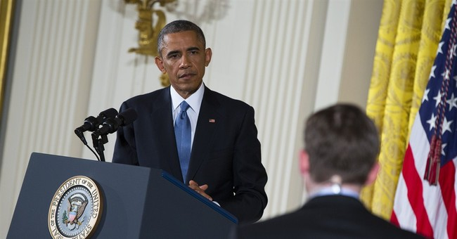 Obama defiant, vows immigration action this year