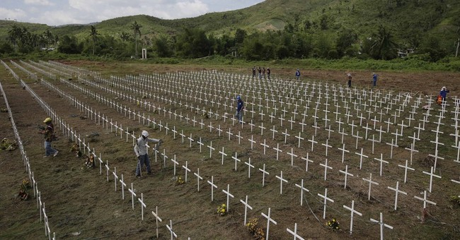 Image of Asia: Marking graves of typhoon victims