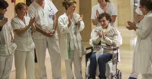 Spain's Ebola nurse leaves hospital, mourns dog