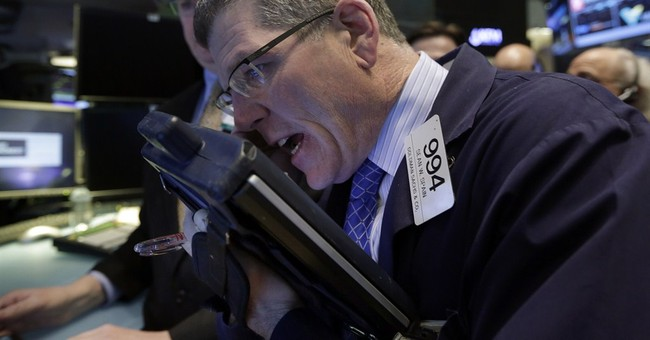 Stocks fall on company earnings, overseas trouble