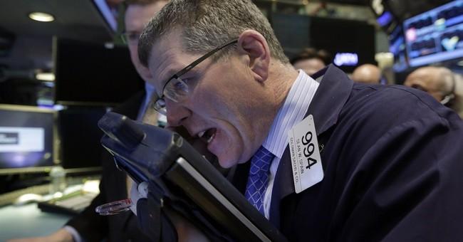 Stocks fall on company earnings, overseas trouble