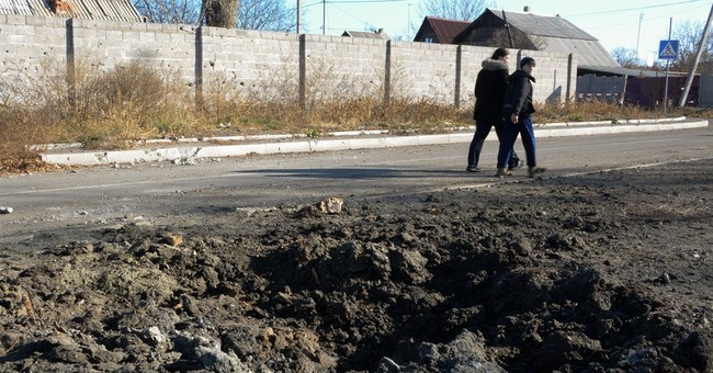 School shelling deaths in Ukraine hurt peace hopes
