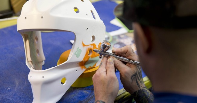 NHL helmets come to life with airbrushed flair